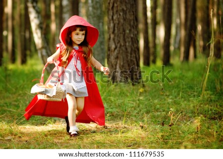 "the girl runs on the wood.  the fairy tale "" Red Riding Hood"" - stock photo"