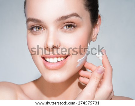 The girl's face after care cosmetics - stock photo