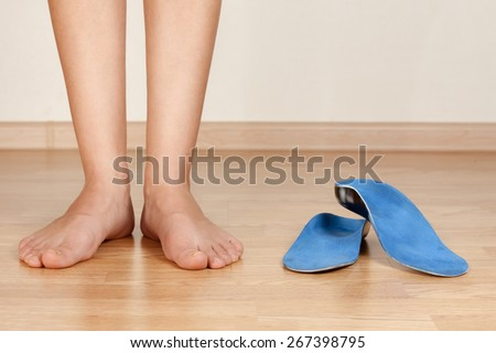 the girl's legs and orthotics - stock photo