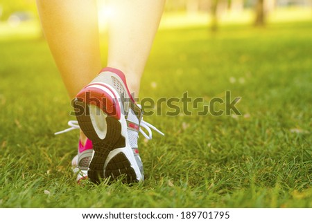 The girl's legs and sport shoes - stock photo