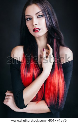 The girl's portrait with red lips and hair to an ombre