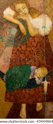 The girl shook the child in the cradle, painting on canvas - stock photo