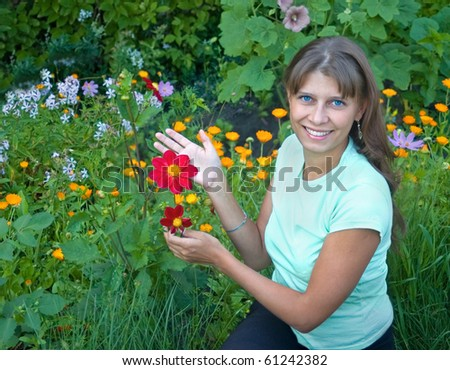 The girl shows a flower on a bed - stock photo