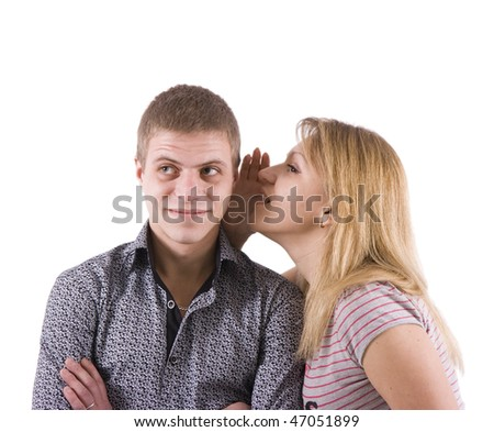 The girl silently tells something to the young man - stock photo