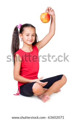 The girl sits with an apple on a white background - stock photo