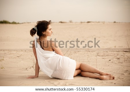 the girl sitting in the desert