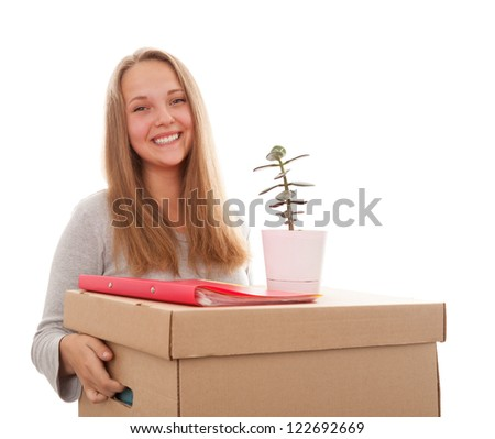 The girl smiles and has control over a box with a house flower on a white background - stock photo