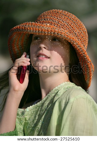 The girl speaking by a mobile phone - stock photo