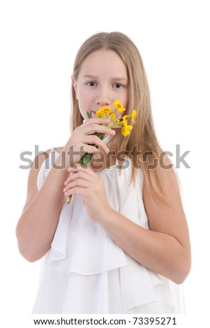 The girl-teenager smells a bouquet of yellow flowers