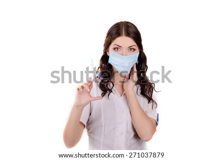 The girl the doctor in a medical mask with a syringe in hands - stock photo
