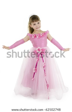 The girl the princess in a pink dress sits opposite to a white background - stock photo