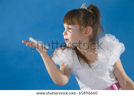The girl the princess in a white dress opposite to a blue background