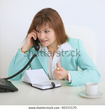 The girl - the secretary emotionally speaks on the phone