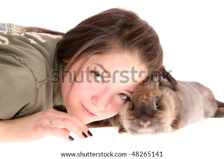 The girl the teenager and a rabbit on a white background, is isolated.