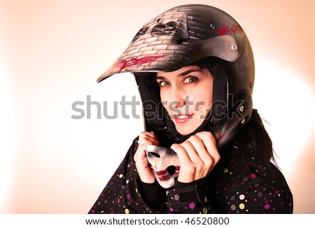 The girl the vampire in a helmet of the motorcyclist.