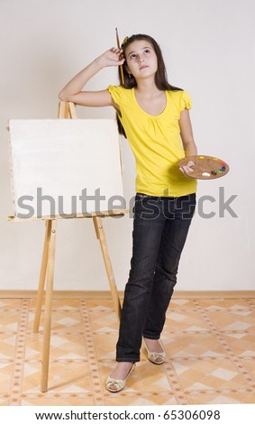 The girl thinks that she draw near Easel