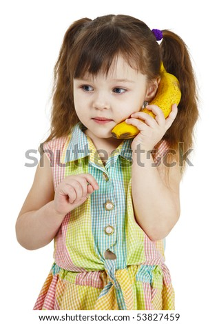 The girl tries to speak by means of a banana instead of phone - stock photo