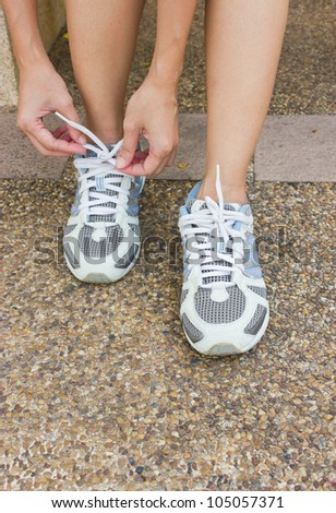 The Girl Tying Running Shoes - stock photo