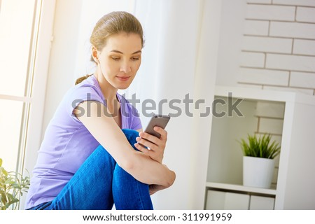 the girl uses the phone