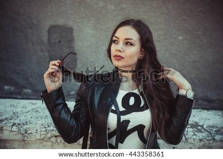The girl walks sunny city - stock photo