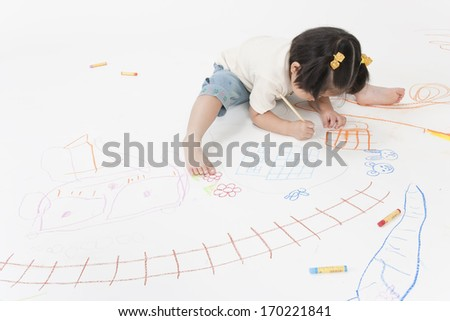 The girl who draws a picture - stock photo