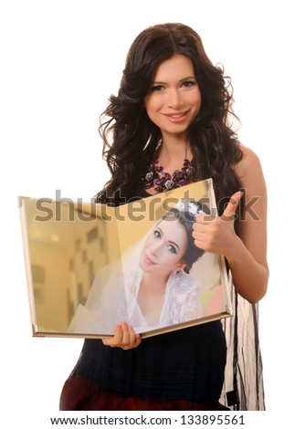 The girl, who had been married, holding a photo album. - stock photo