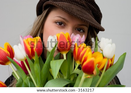 The girl with a bouquet of tulips