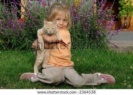 the girl with a cat - stock photo