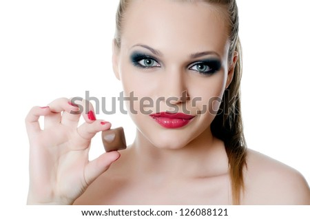 The girl with a chocolate candy isolated