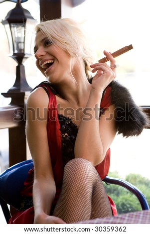 The girl with a cigar.