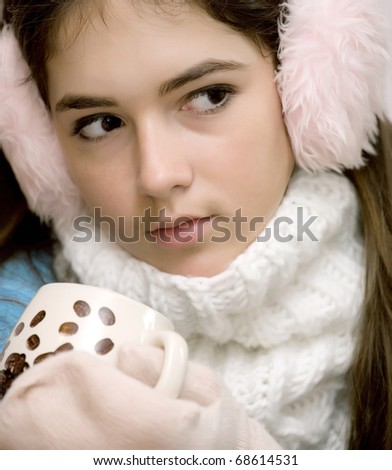 The girl with a coffee cup - stock photo