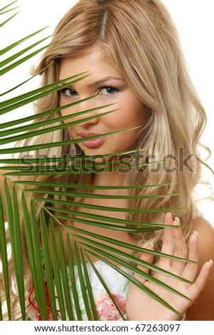 The girl with a green leaf - stock photo