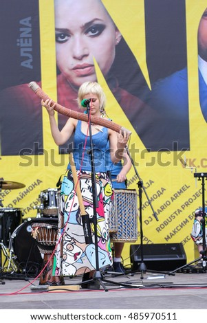 The girl with a rare musical instrument. St. Petersburg, Russia - 13 August, 2016. Africa and the Russian Culture Festival on Krestovsky Island in St. Petersburg.