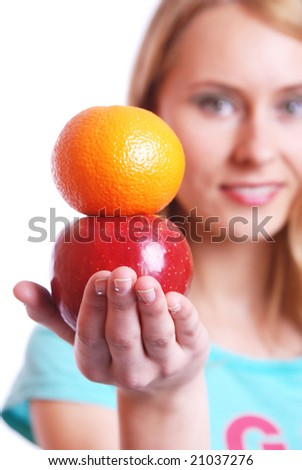 The girl with a red apple and an orange - stock photo