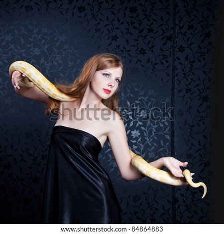 The girl with a snake - stock photo