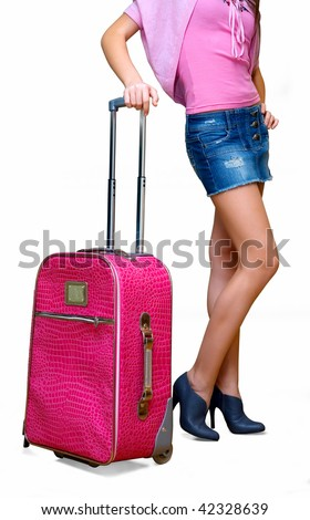 The girl with a suitcase in a pink jacket. It is isolated on a white background - stock photo