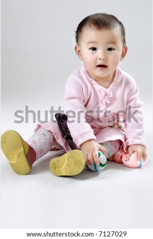 The Girl with a toy - stock photo