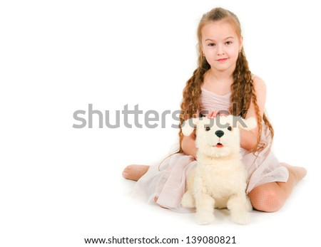 The girl with a toy puppy on a white background