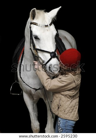 The girl with a white horse on a black background... - stock photo