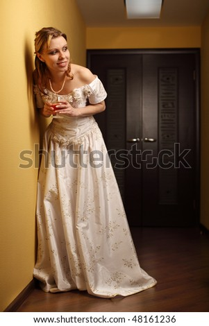 The girl with a wine glass in a white dress