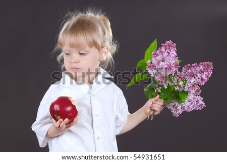 The girl with an apple and flowers