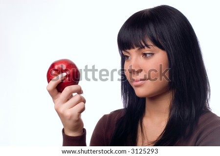 The girl with an apple on a white background