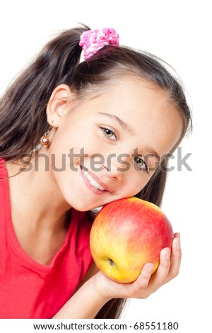 The girl with an apple, white background - stock photo
