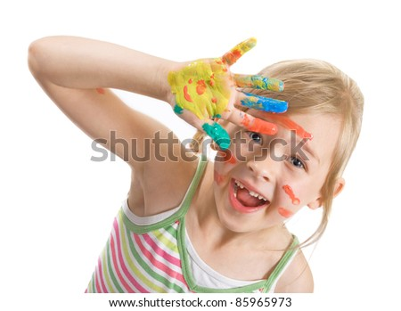 The girl with bright paints on hands