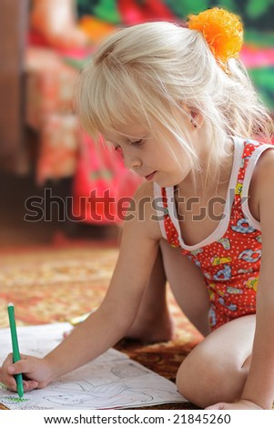 The girl with enthusiasm draws sitting on a floor - stock photo
