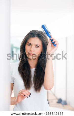 The girl with hairbrush in her hand