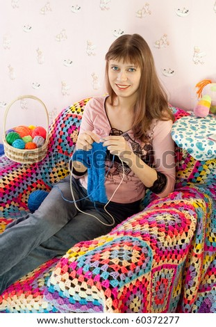 The girl with knitting in hands - stock photo
