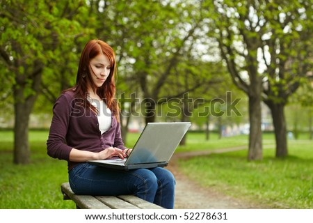 The girl with laptop on outdoor - stock photo