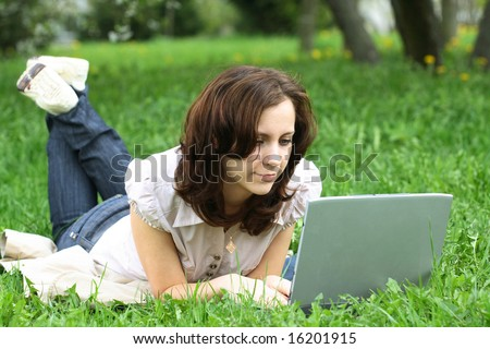 The girl with laptop on the nature