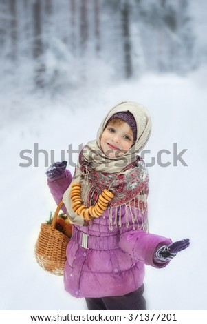 the girl with sushka in the winter afternoon